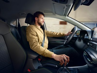 A man driving the all-new Hyundai i20, co-driver's perspective