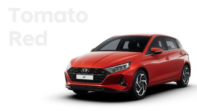 Front right view of the all-new Hyundai i20, Tomato Red colour scheme
