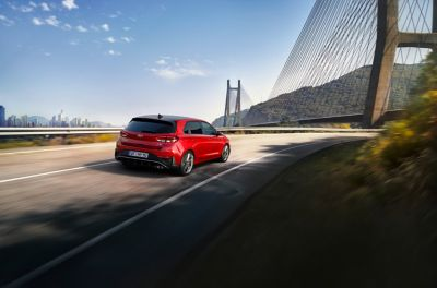 The new i30 Hatchback N Line driving towards a bridge.