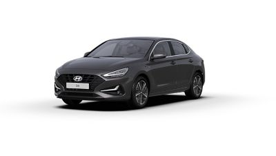 Front side view of the new Hyundai i30 Fastback in the colour Dark Knight Grey.