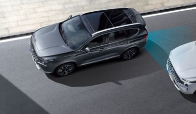 The new Hyundai Santa Fe Hybrid from above highlighting the Advanced Driver Assistance Systems.